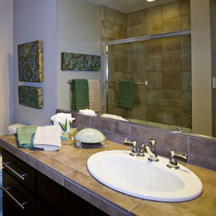 Image of a bathroom staged with hand towels and accessories by Susie Buchanan