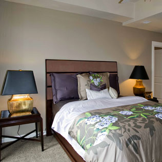 image of a bed with brown headboard and custom pillows.